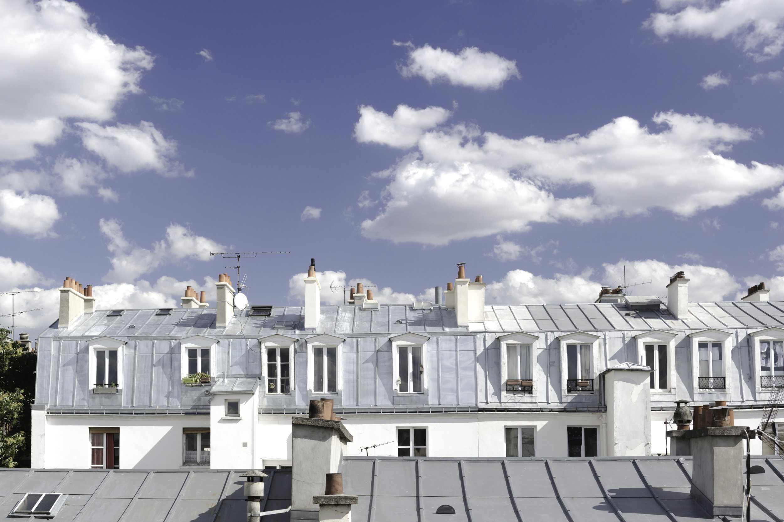 TOITS DE PARIS   Emblematic Mansard Roofs on a bright day