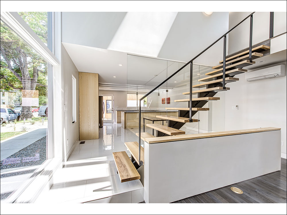 Custom kitchen and main staircase fabricated by PAPER AIRPLANE