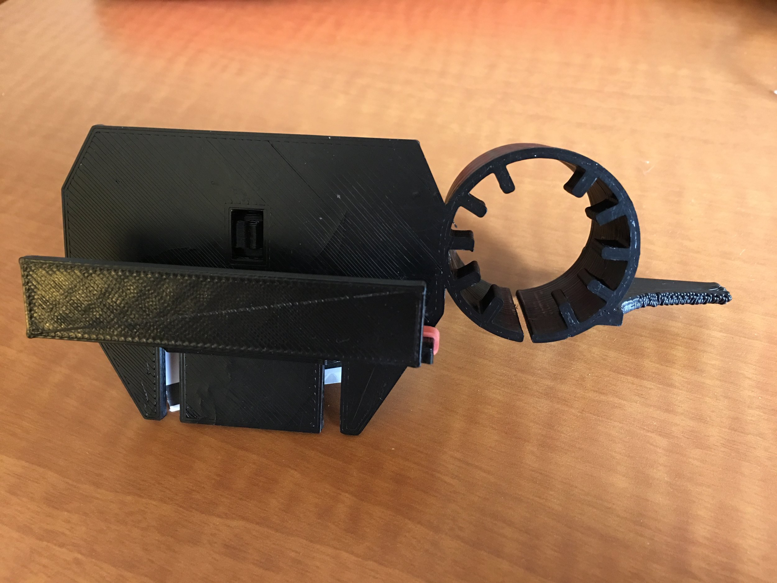 The J-Mount from the front. The barrel section can accommodate larger eyepieces to allow for a secure fit, while the ribs on the inside of the barrel maintain proper Z-distance. Shims (not pictured) can adjust the Z-distance for those with thin or no case on their smartphone. Additionally, the J-Mount can be customized with a logo on the movable Y-adjustable platform. Please contact us if interested in device customization.