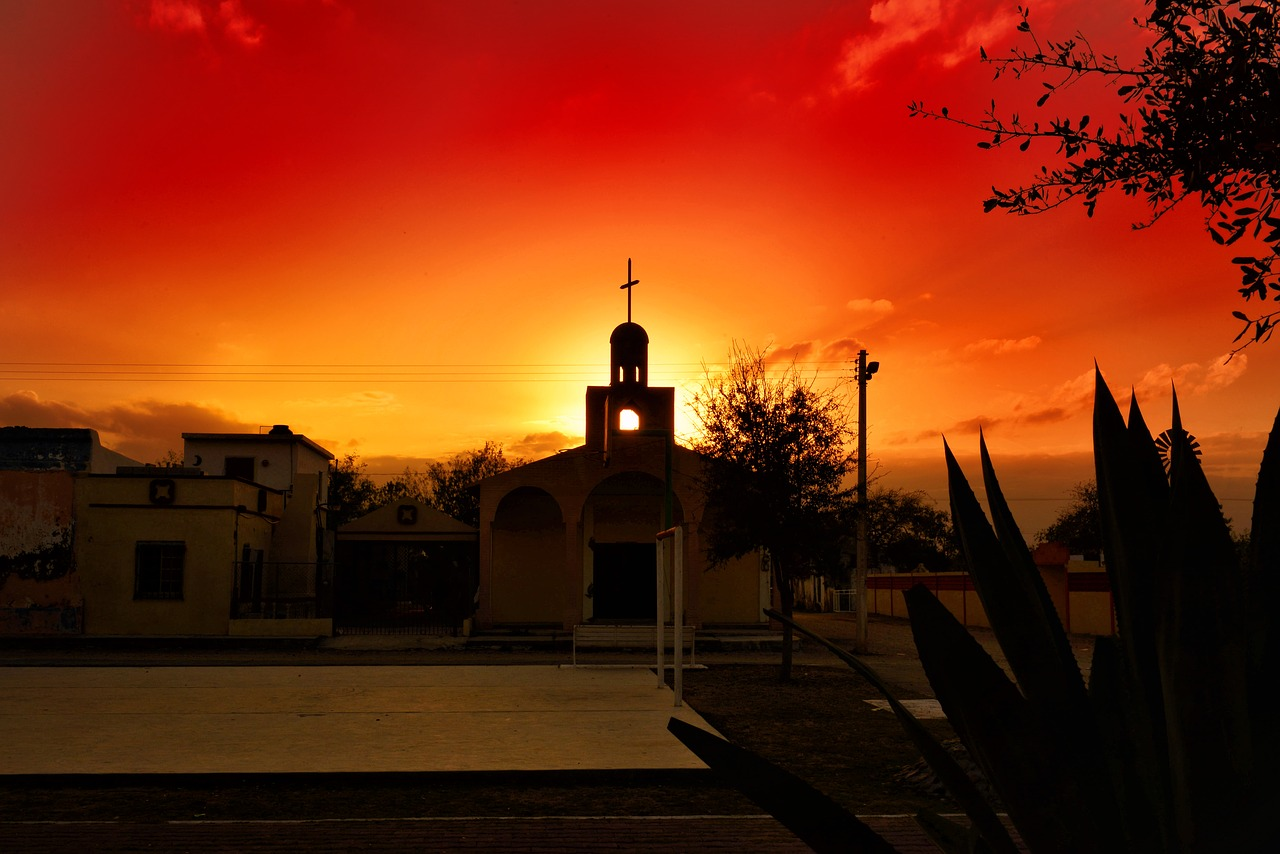 Gorgeous read sunset behind a Mexican church