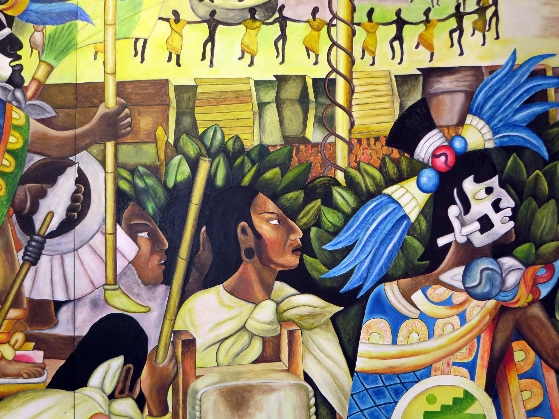 A brilliantly colored Mexican mural showcasing Aztecs.