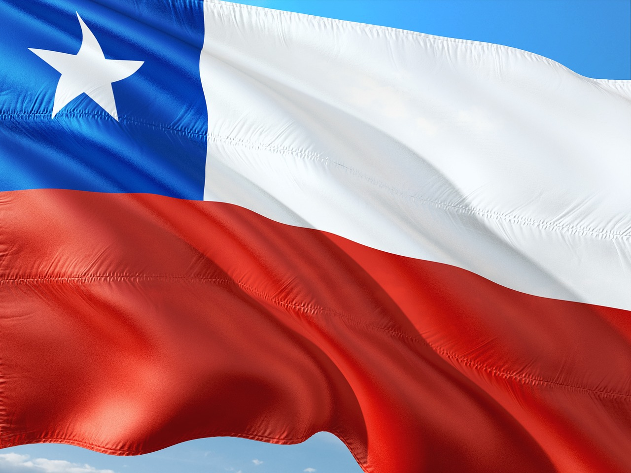 A Chilean flag blowing in the wind.
