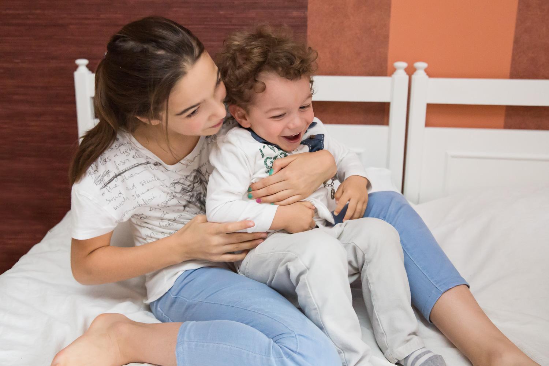 sandra ruth stuttgart family photographer Big Sister Cuddling Little Brother.jpg