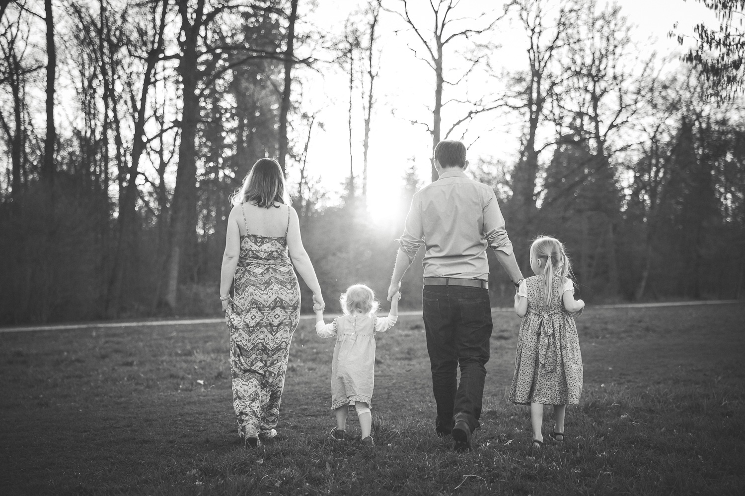 Sandra Ruth Photography Parents and Kids walking towards sunset.jpg