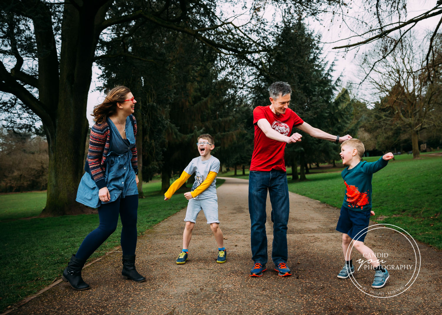 Harborne UK Family with two boys dancing in park