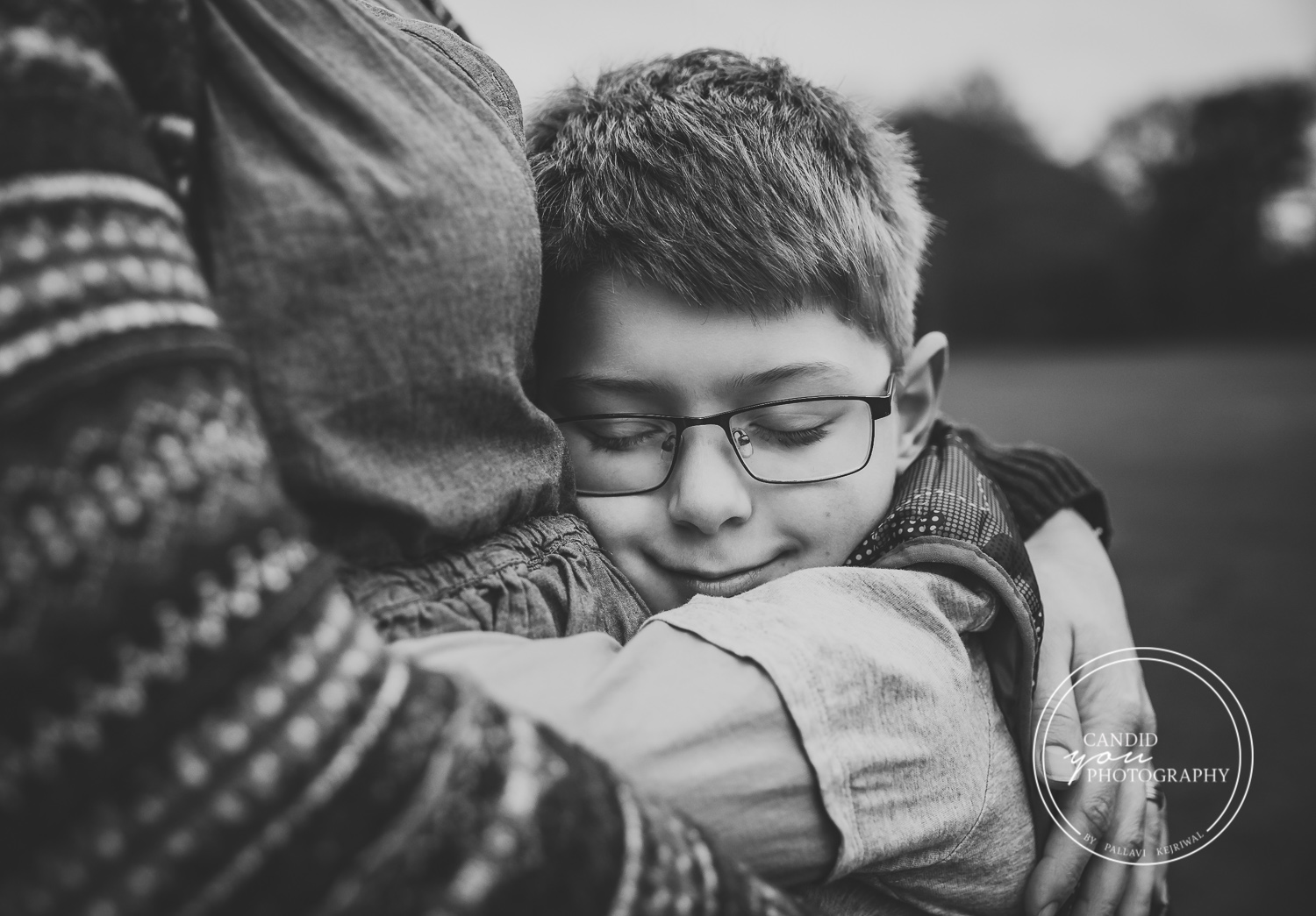 boy of nine tightly hugs mum