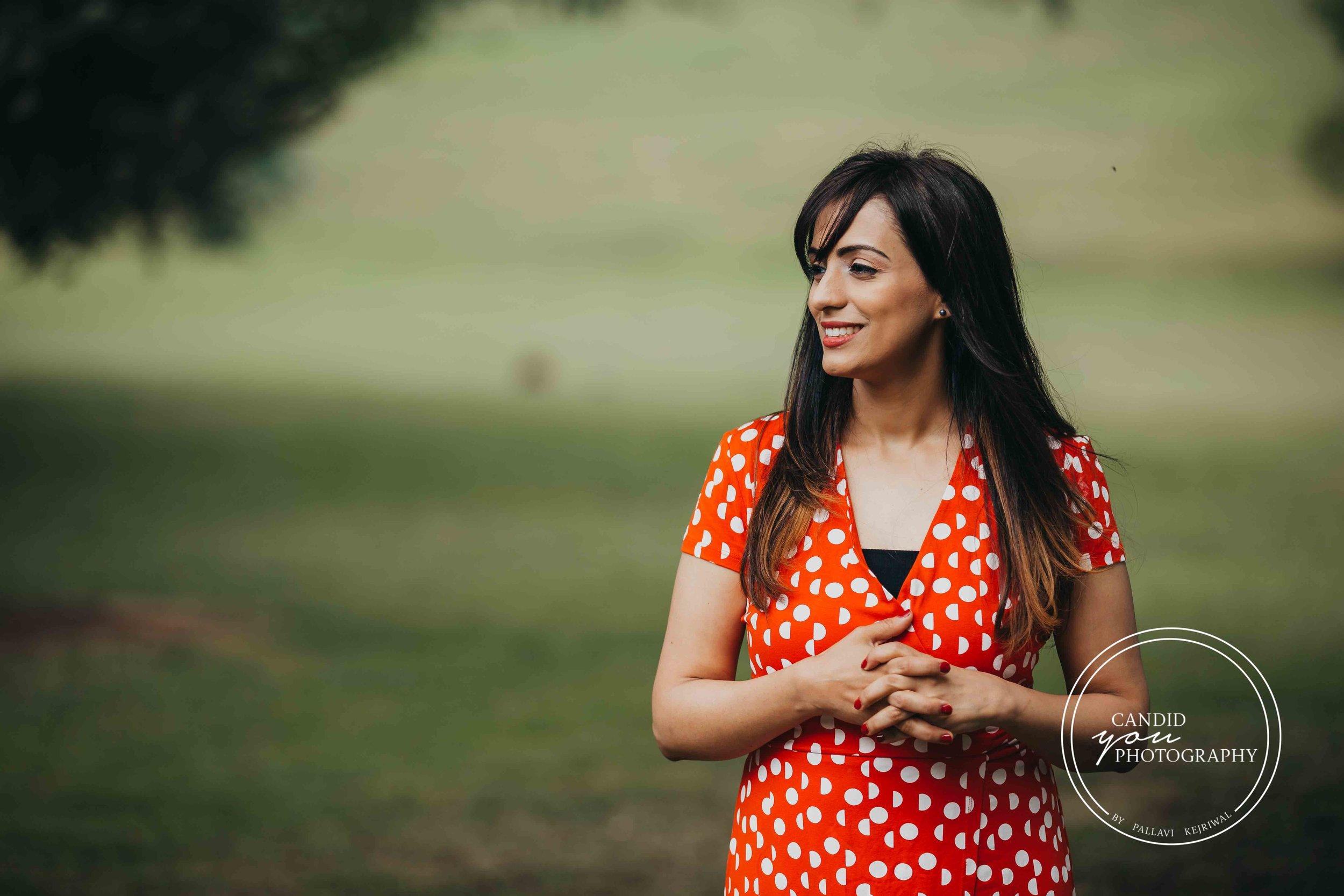 Beautiful lade in park in orange polka dot dress