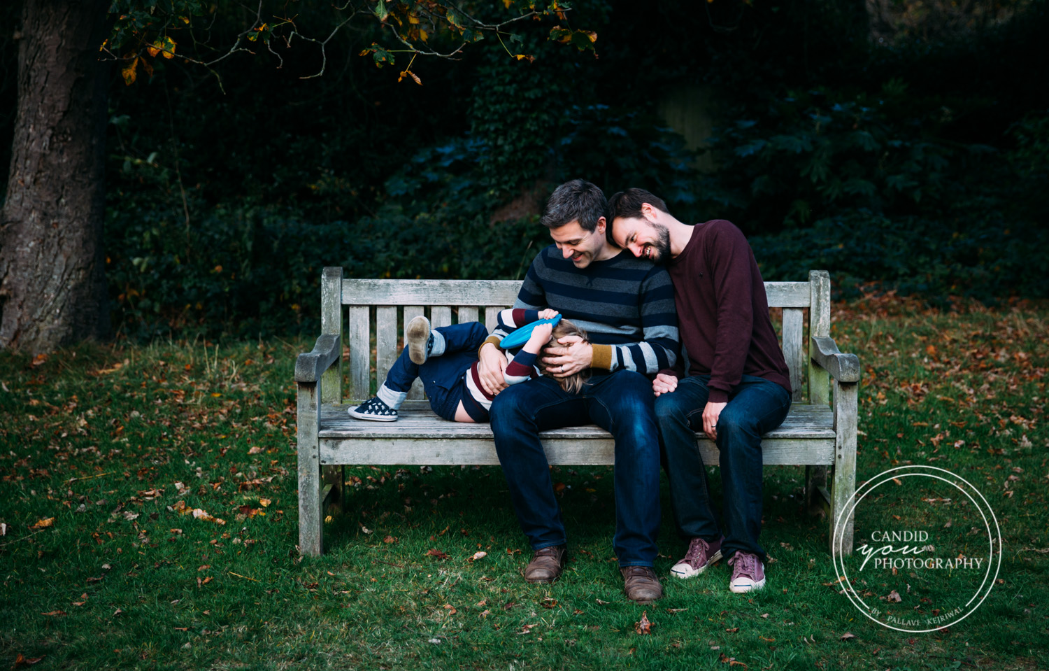 LGBTQ Dads lovingly look towards their son