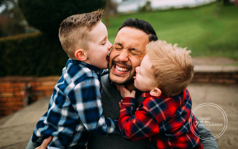 boys lick fathers face joyously