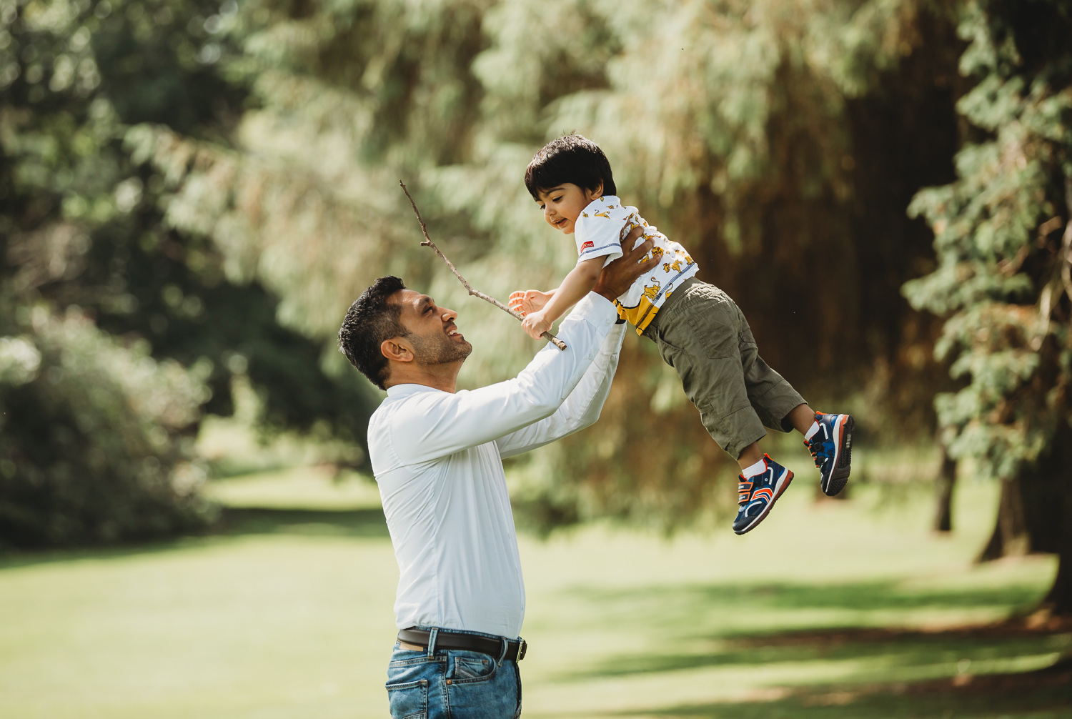 dad flinging 2 year old son in air with love