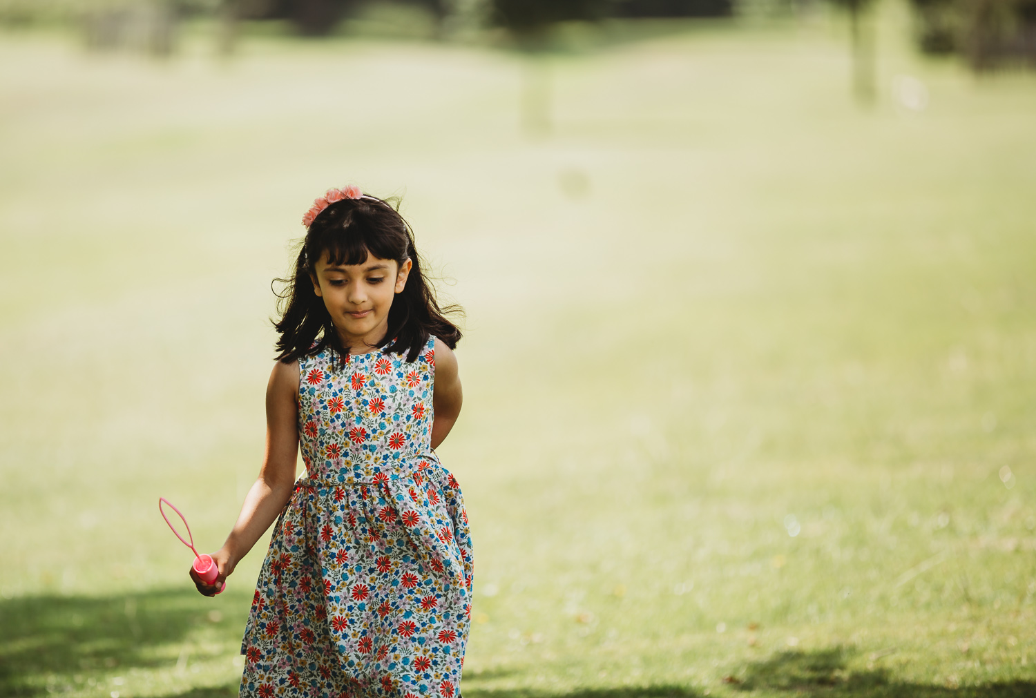 little girl of 4 walking confidently in a park