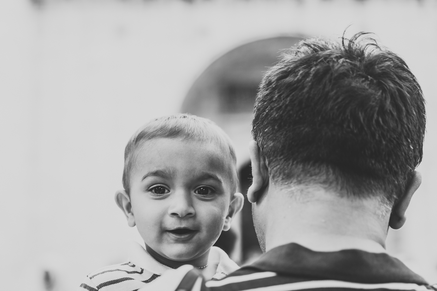 boy with his dad looking at the camera