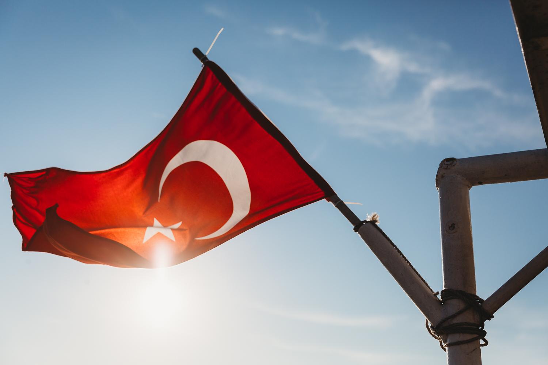 flag of turkey against the shining sun