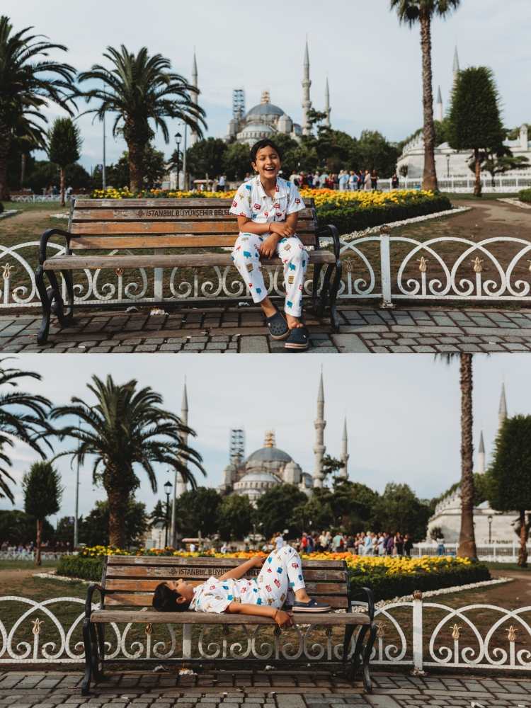 7 year old boy laughing in front of blue mosque istanbul