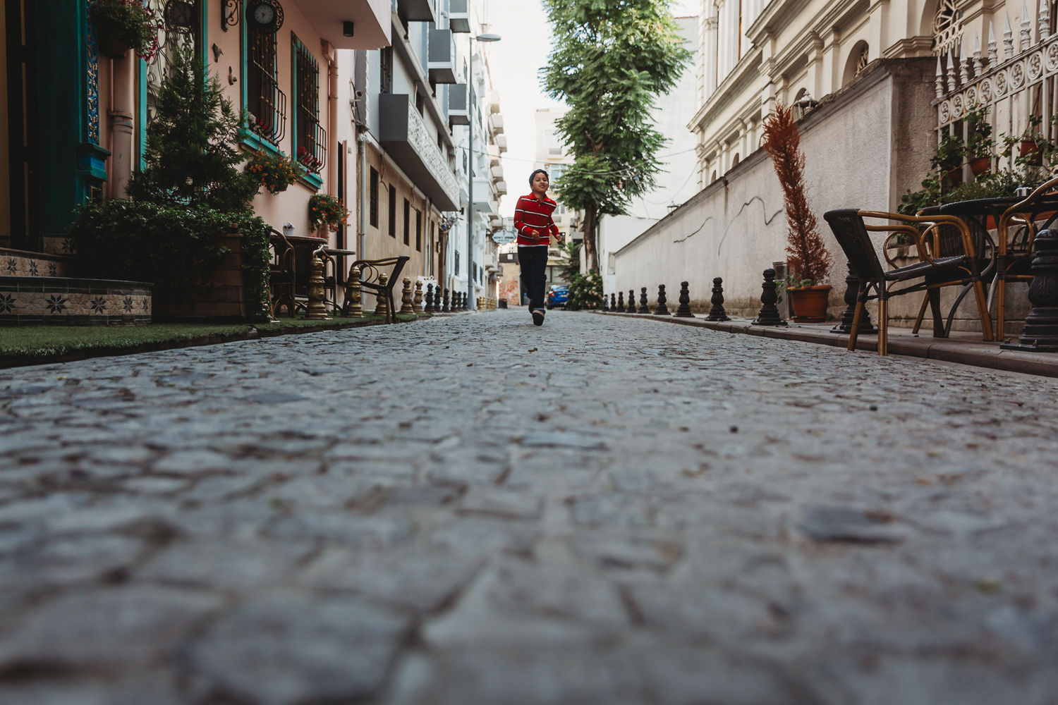 boy running on cobbled streets