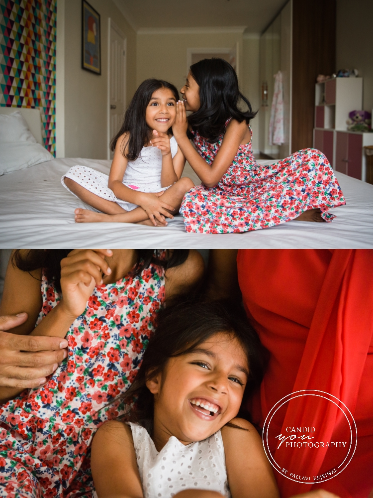 sisters sharing secrets and enjoying during in home family photo session