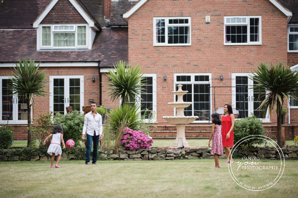 family enjoying in garden during in home family photo session