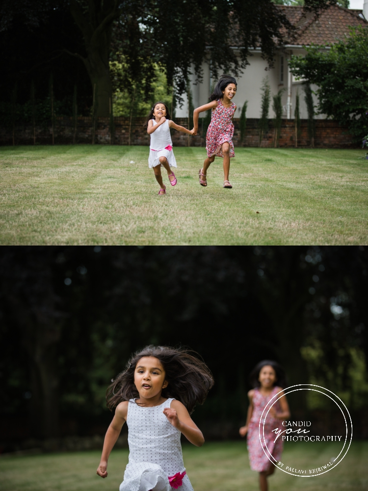 girls enjoying and running in their backyard during in home family photo session