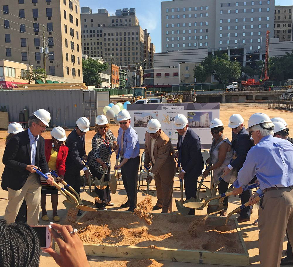 """Midtown Park is located on the site of the once iconic parking structure known as """"Midtown Parking."""" As part of the complex, 200 apartments, retail, and 500+ much needed parking spaces are planned to be completed sometime in 2018."""