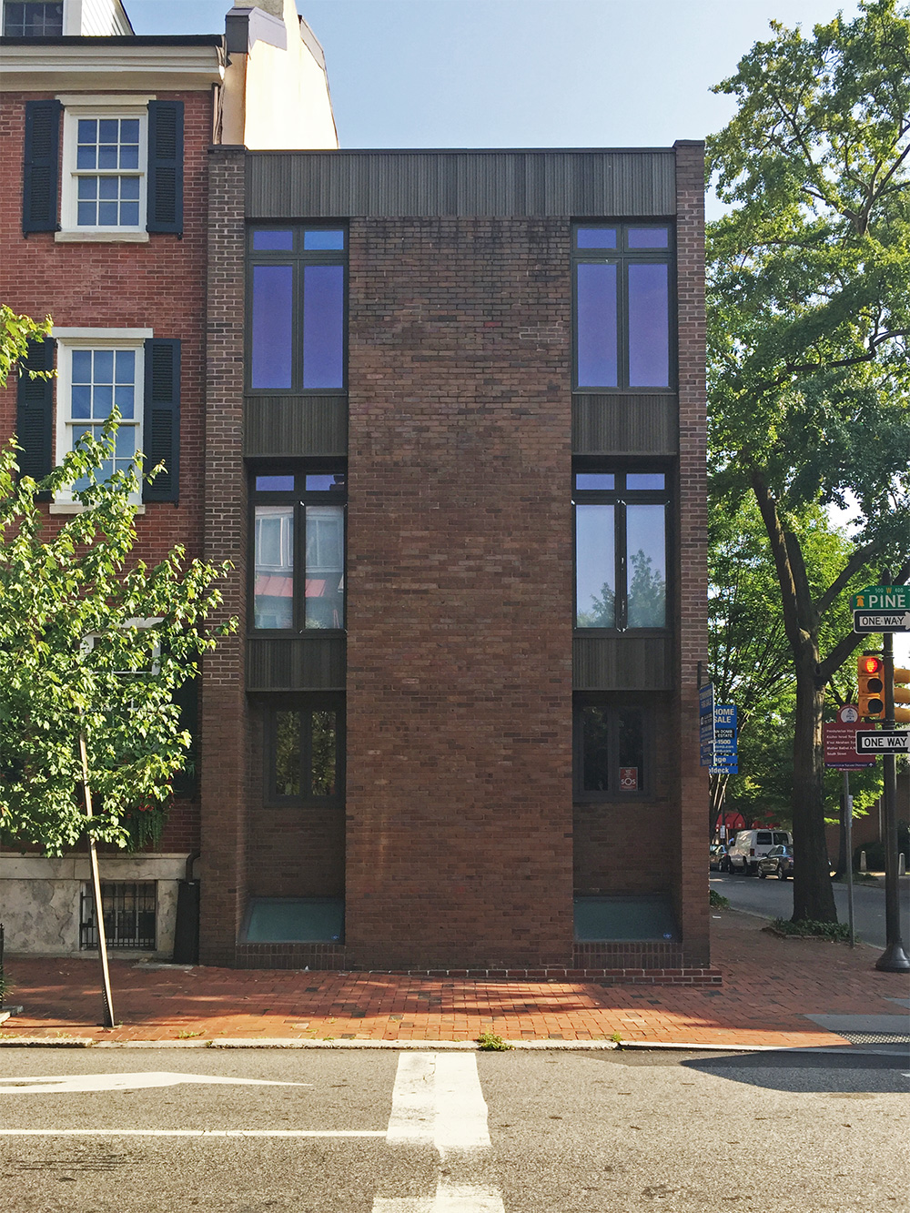 Photo of a Brick Modern home at the corner of 5th and Pine Streets.