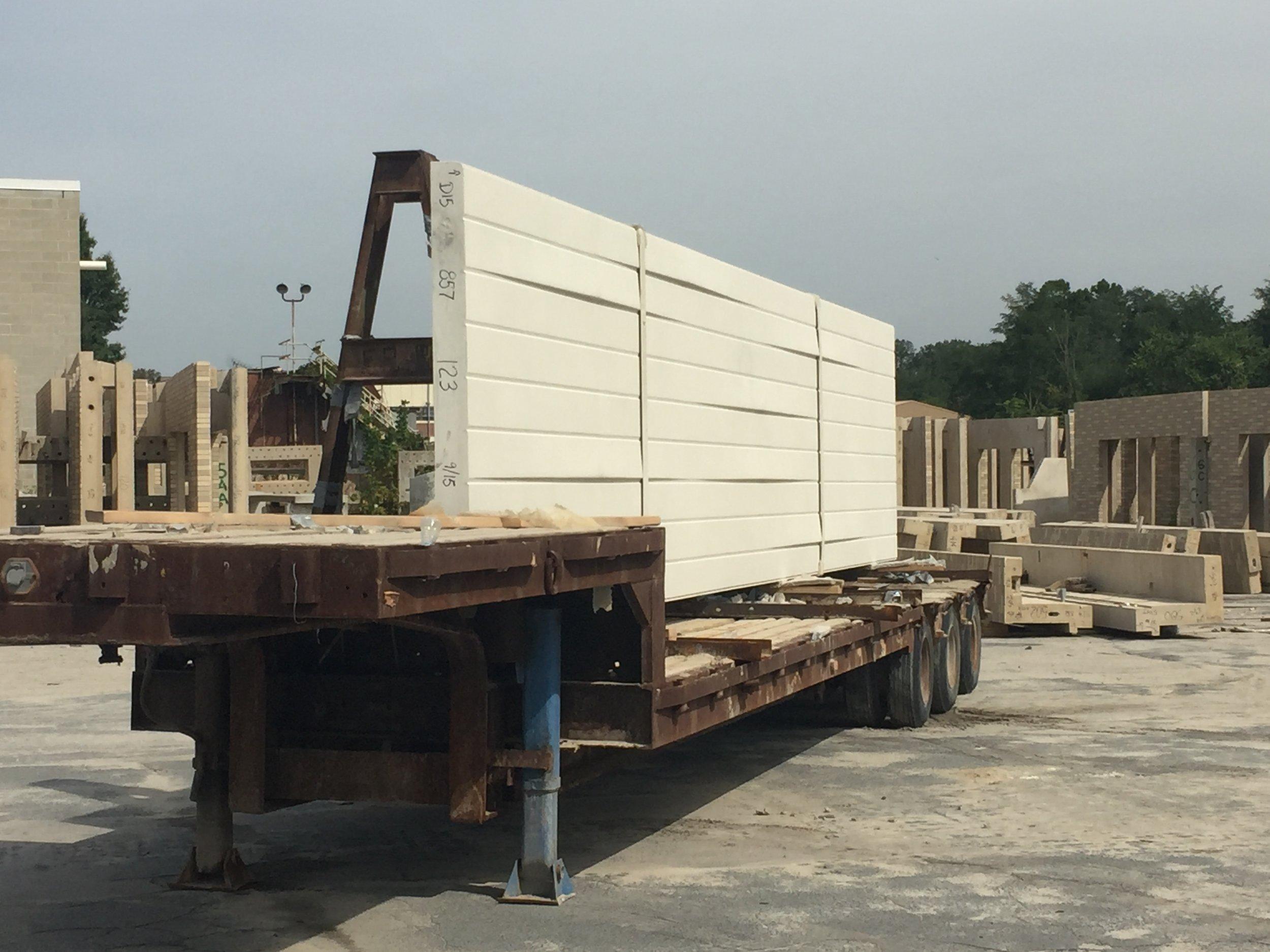 Precast panel on truck prepared for delivery.