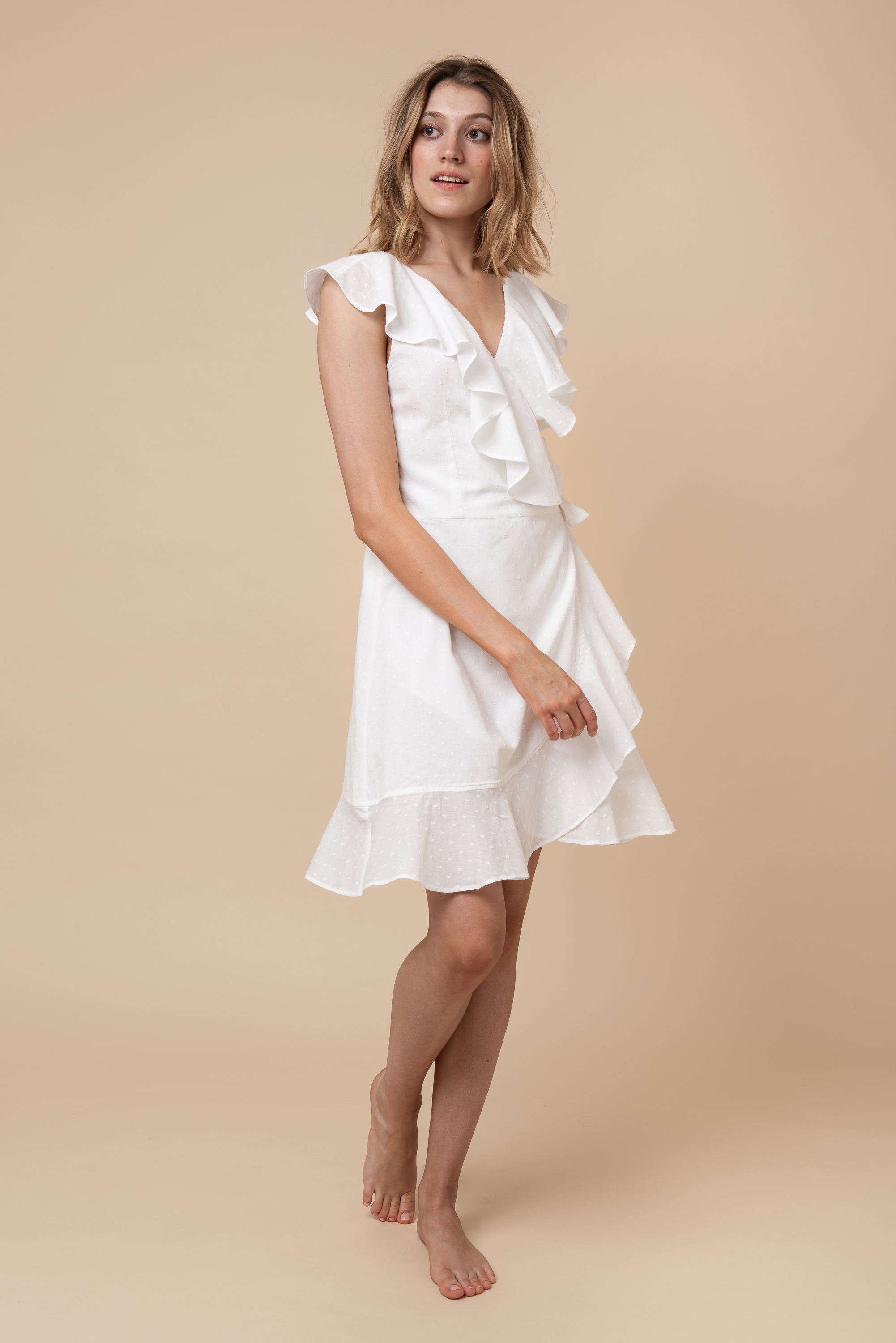 THE CLAIRA A versatile one size fits all wrap dress with an adjustable waist band for maximum flexibility.