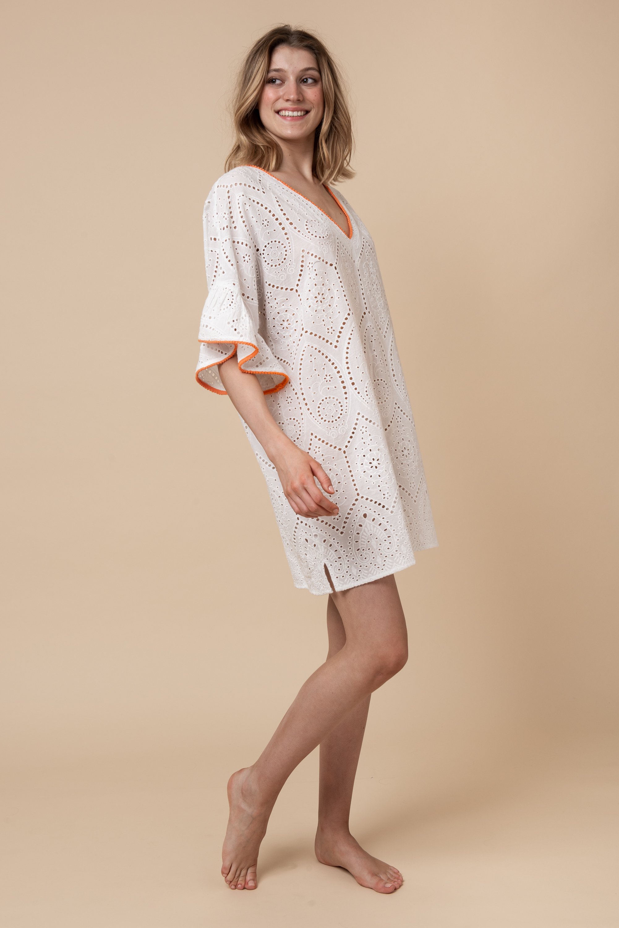 THE KIKI A white broderie anglaise one-size-fits-all pull-over beach kaftan designed to complement every body shape.
