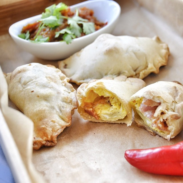 New fav! #hevosrancheros #empanadas with fresh red hot pepper salsa!!