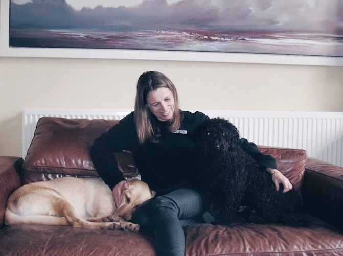 Sarah Halliwell, pictured here with her adorable pooches, chief taser - Frosty and Pedro the Spanish water dog.