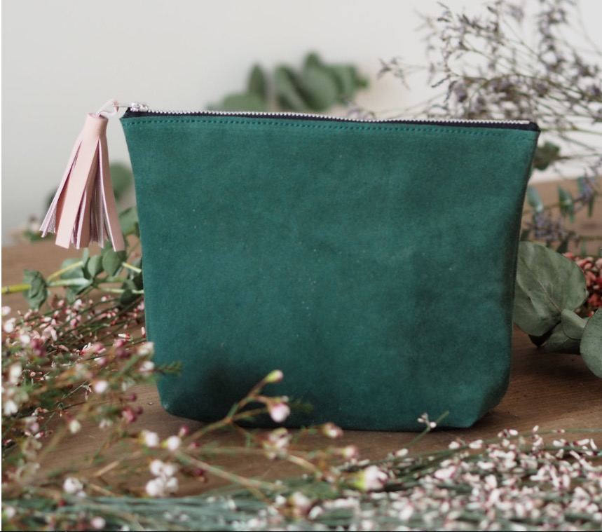 Rosie's beautiful custom tassel pouch in moss green suede.