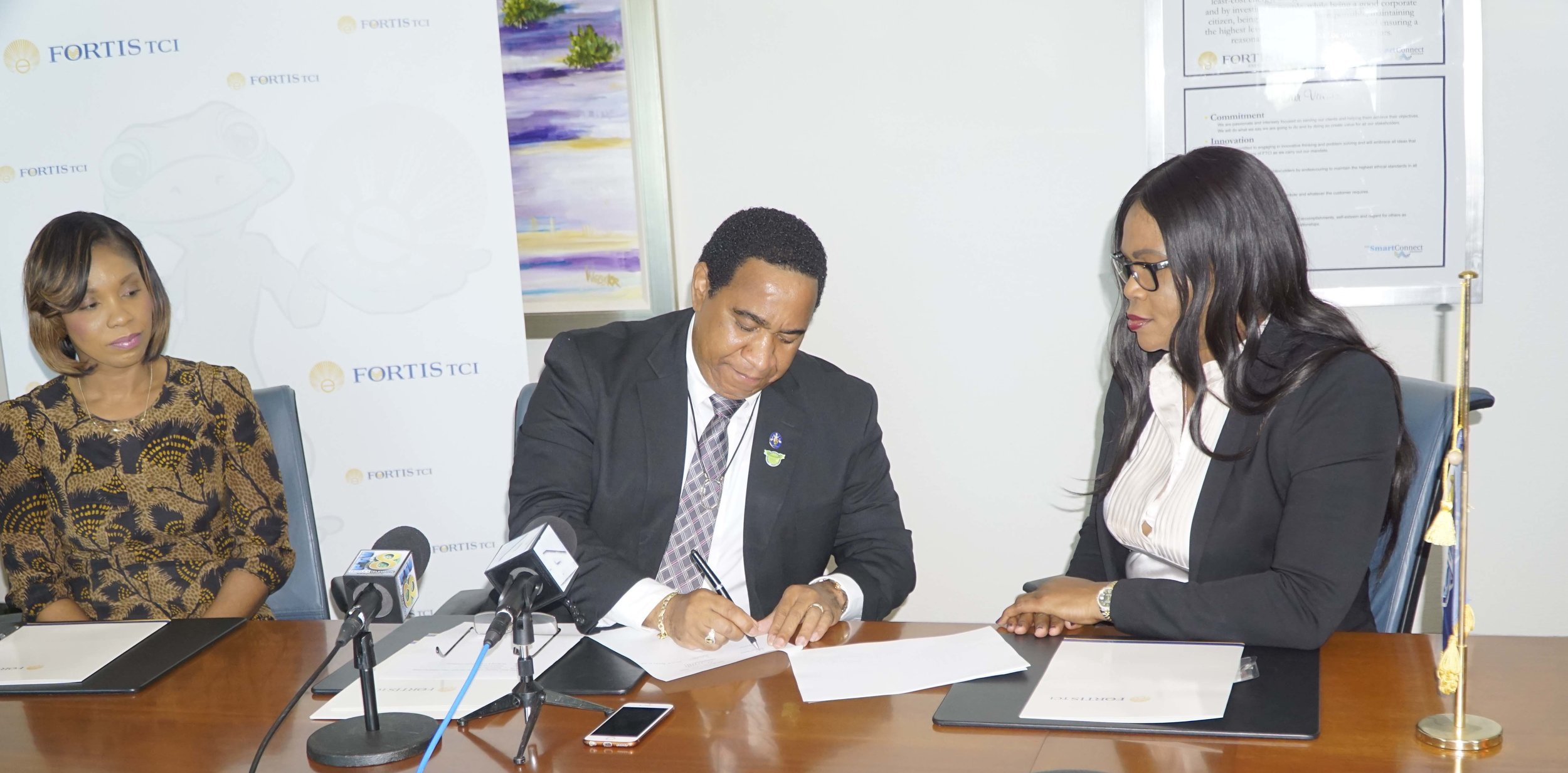 Signing of the contract by Fortis TCI President Eddinton Powell, and TCIFA President Sonia Bien-Aime, February 6, 2017
