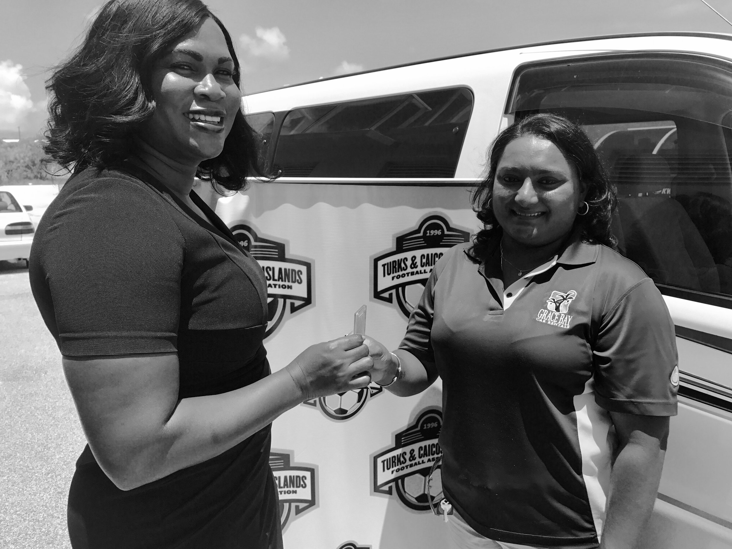 (L-R) TCIFA President, Sonia Bien-Aime, and Keisha of Grace Bay Car Rentals
