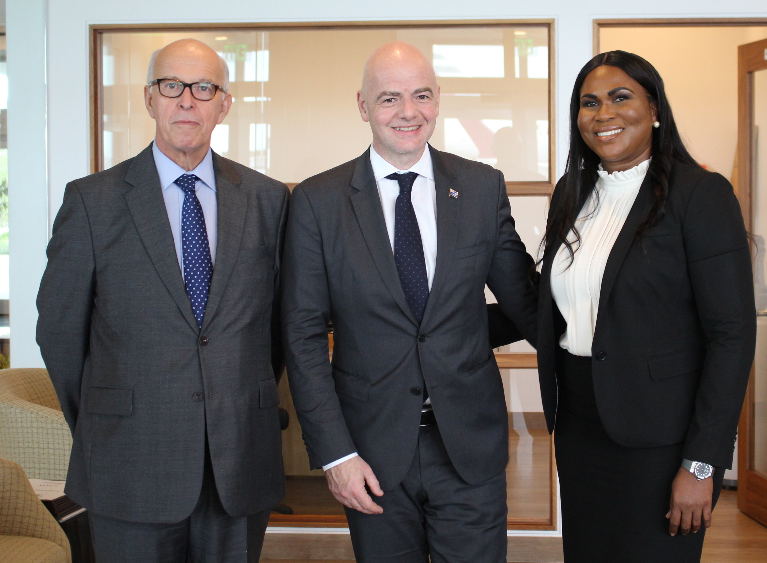 His Excellency Dr. John Freeman, FIFA President Gianni Infantino, TCIFA President Sonia Bien-Aime