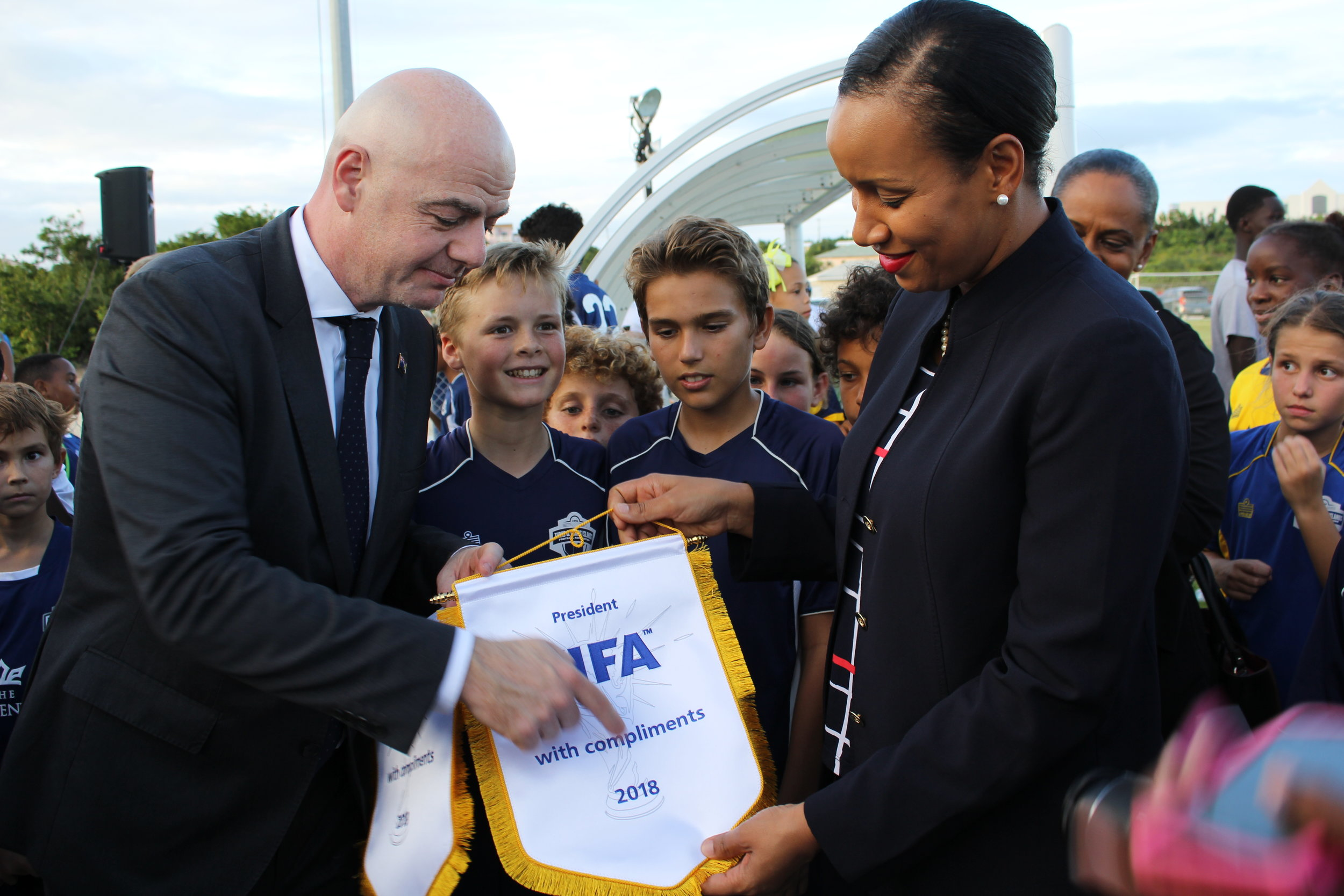 FIFA President Gianni Infantino gifting Deputy Governor Her Excellency Hon. Anya Williams with a FIFA Pennant