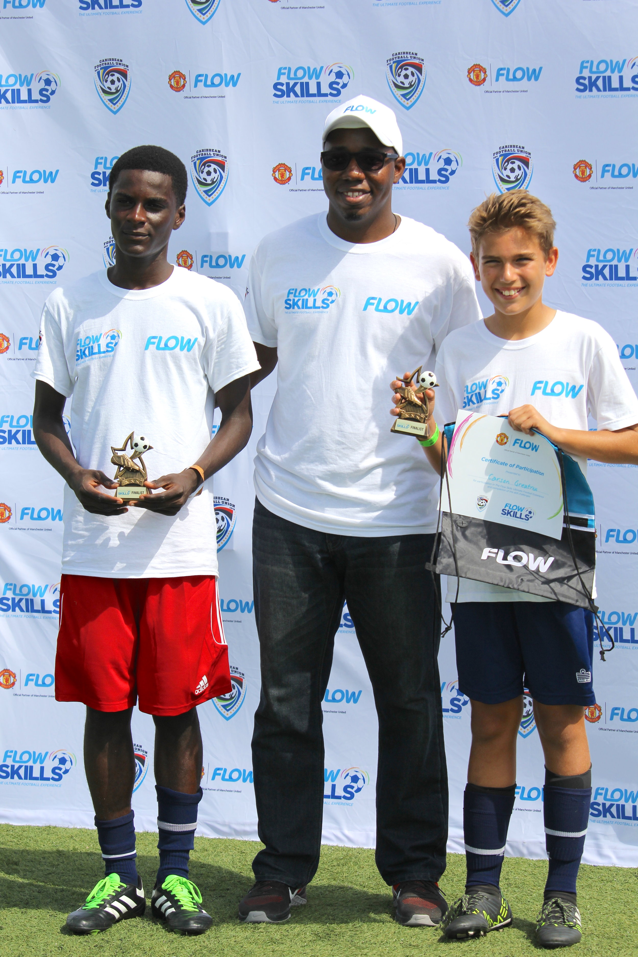 (L-R) Rosmith Messieur, Darron Hilaire (FLOW TCI Marketing Executive), and Carson Greatrex