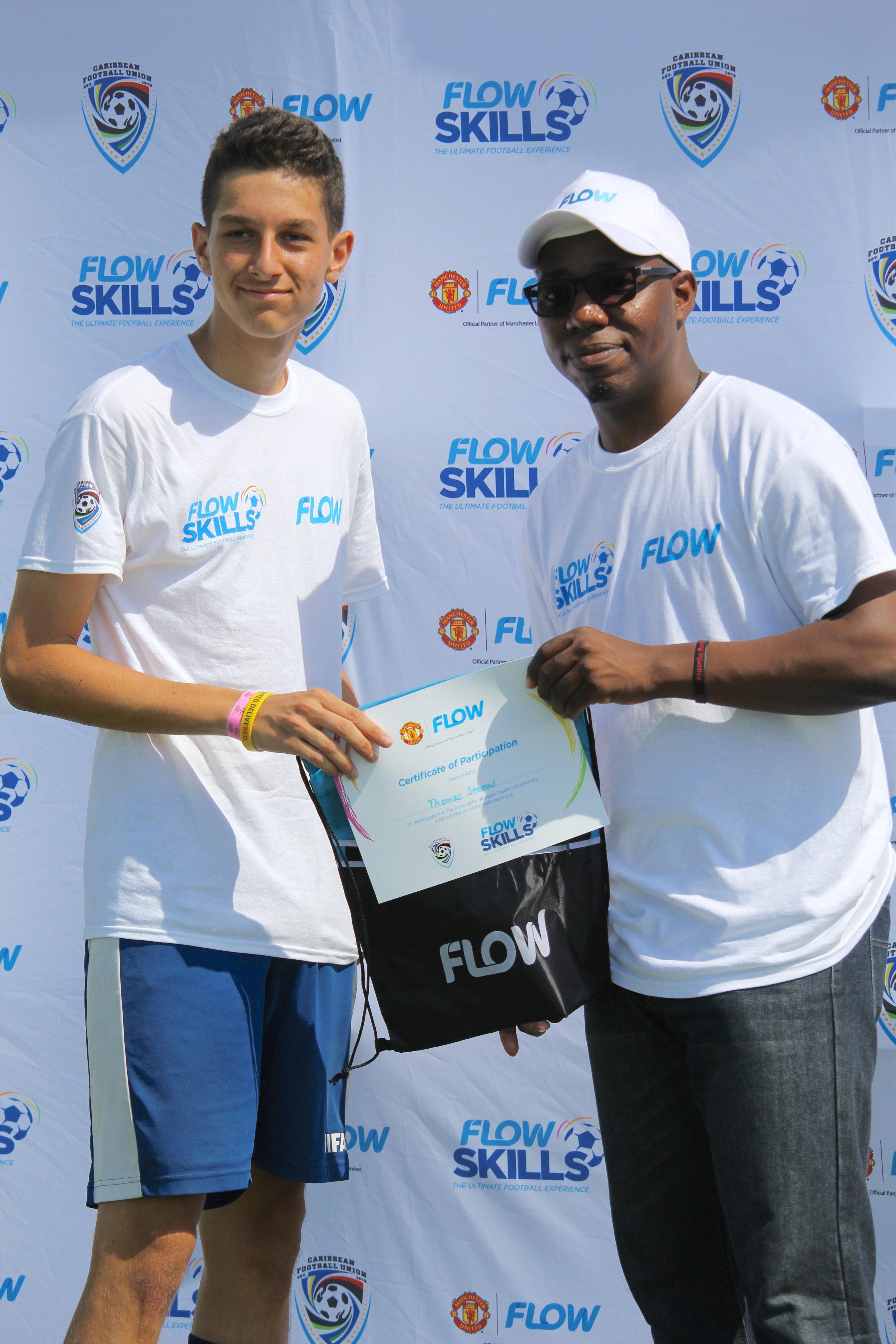 (L-R) Thomas Stephen and Darron Hiliare (FLOW TCI Marketing Executive)