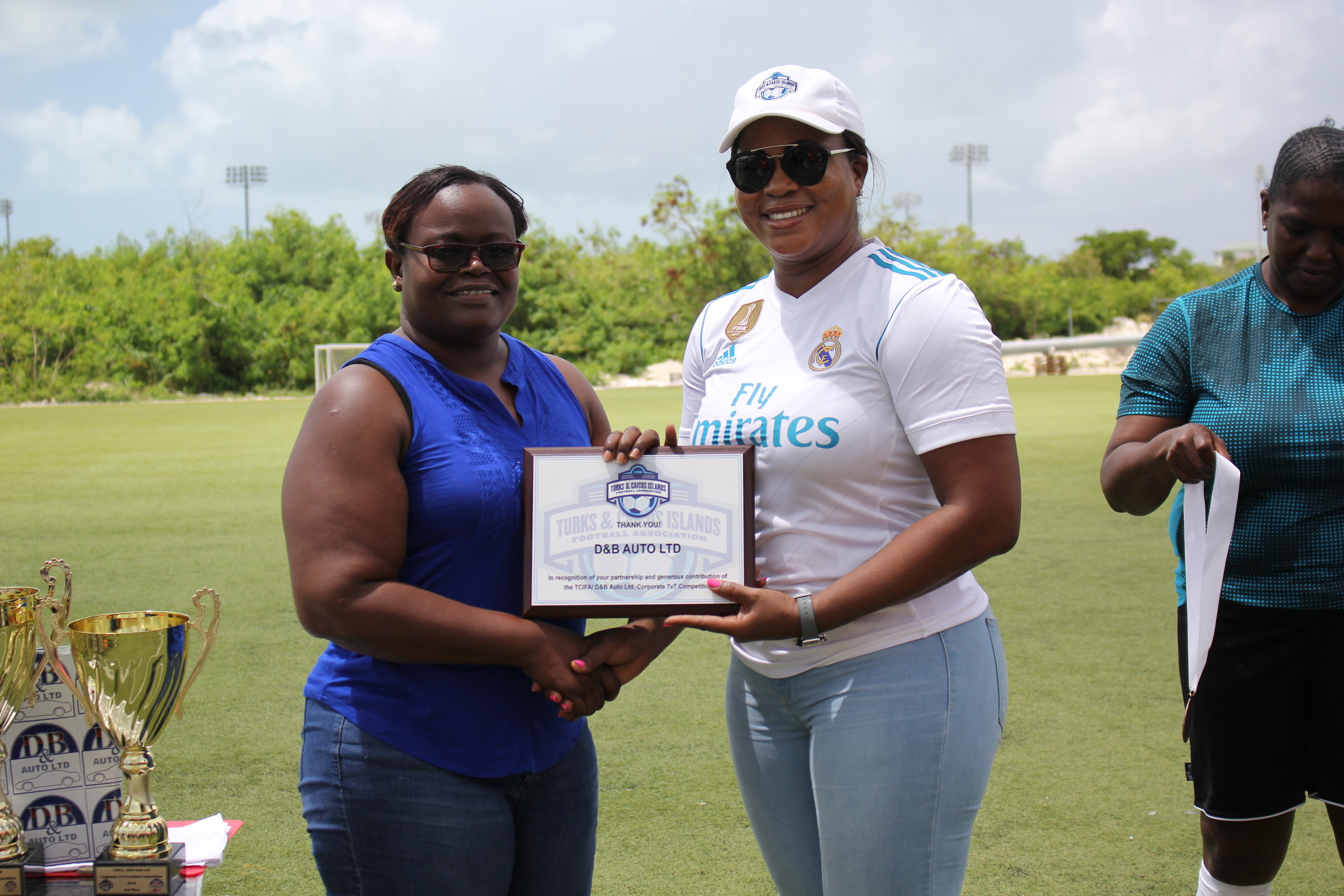 Brittannya Daley of D&B auto presented with a plaque by TCIFA President Sonia Fulford