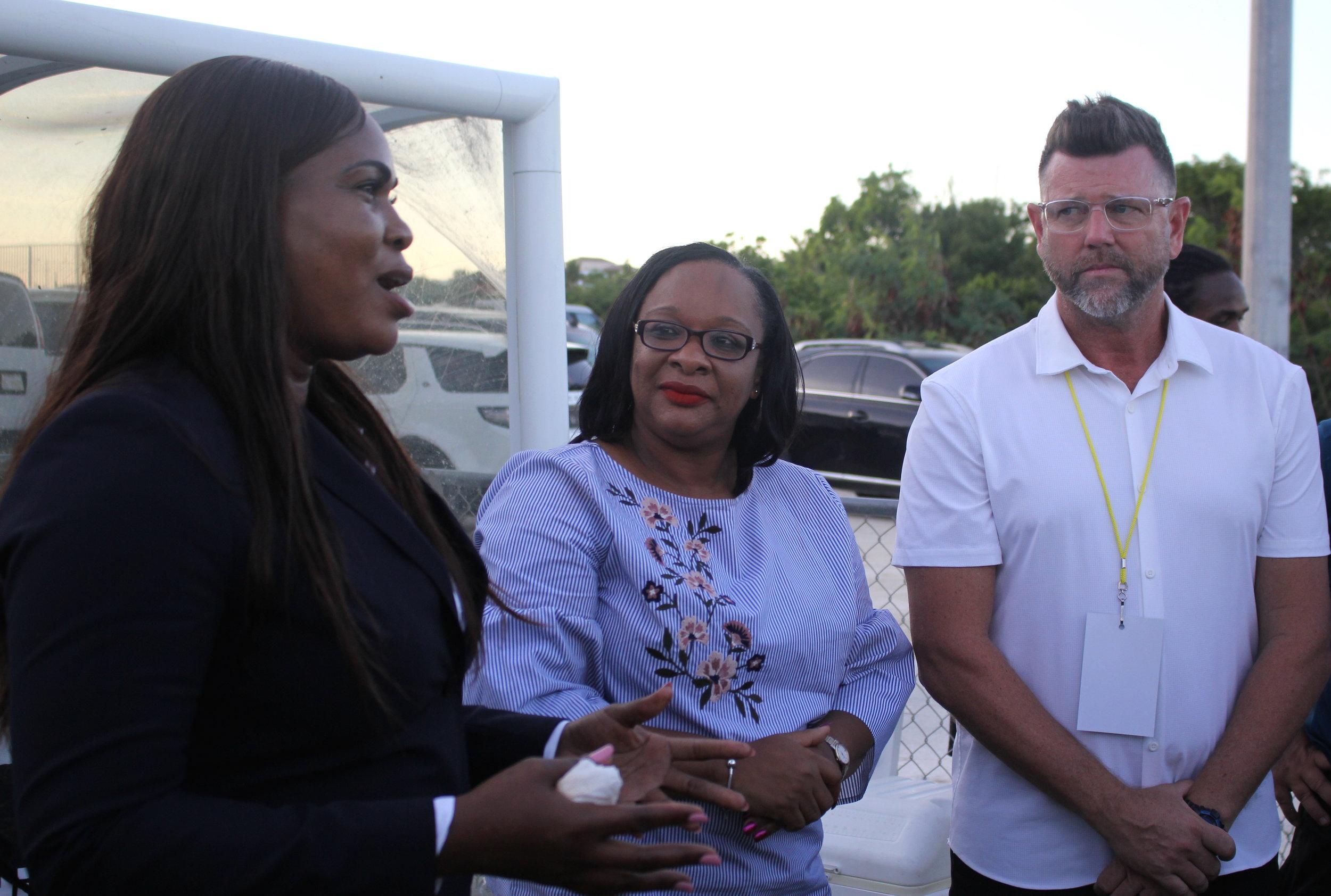 TCIFA President Sonia Fulford, Hon. Sharlene Cartwright Robinson and TCI Head Coach Matthew Barnes