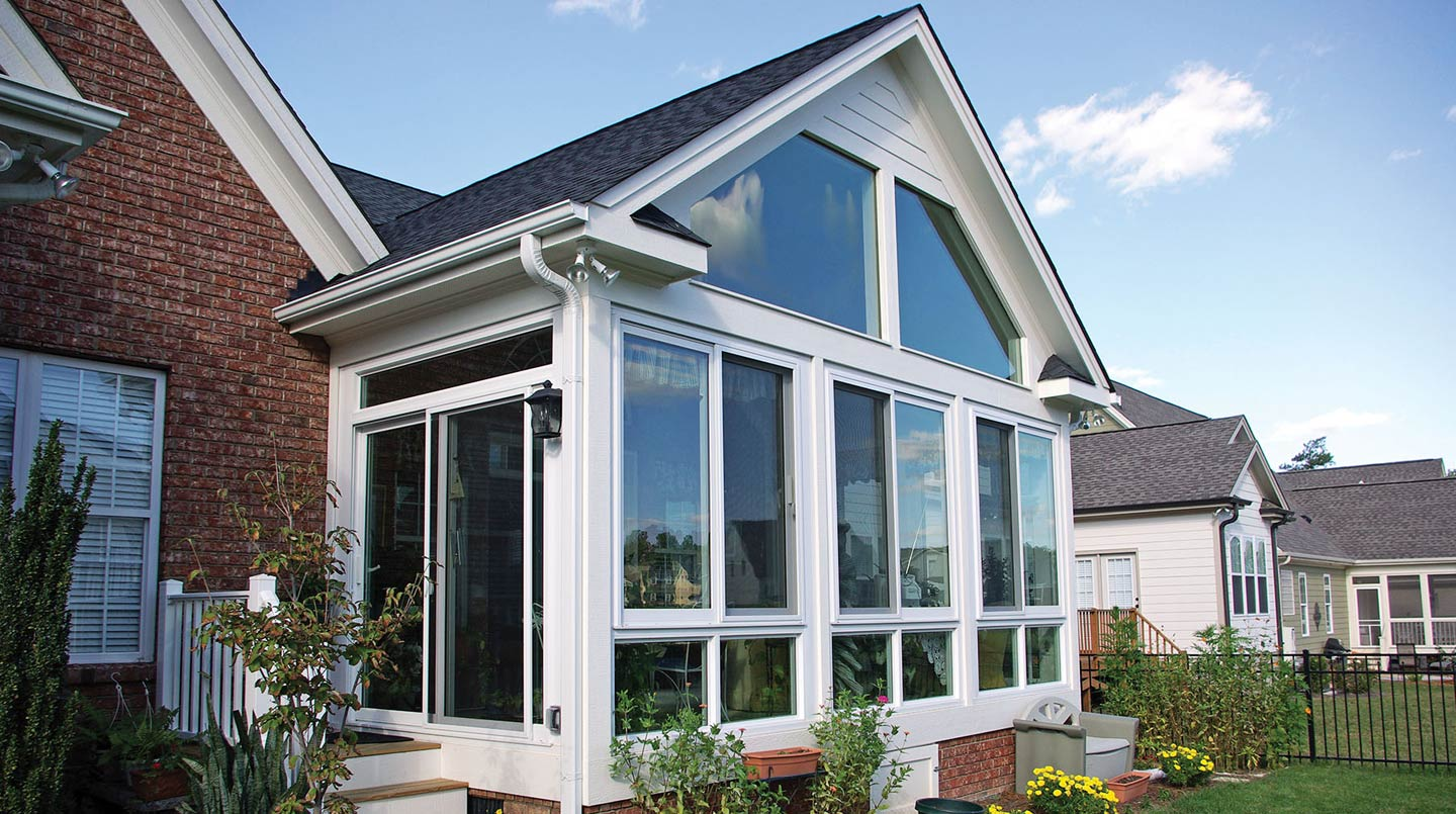 home-design-enchanting-sunroom-ideas-with-gable-roof-and-glass-windows-plus-white-wood-siding-perfect-relaxation-sunroom-ideas-with-glass-wall-and-cozy-furniture-window-treatments.jpg