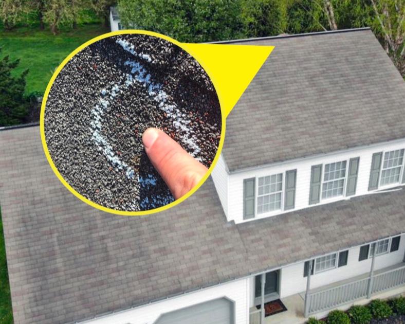 house with close up of hail damage.png