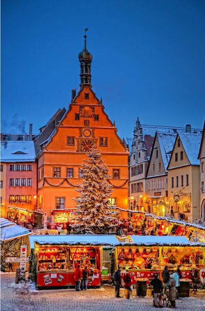 A  Christmas market in Rothenburg  attracts visitors.