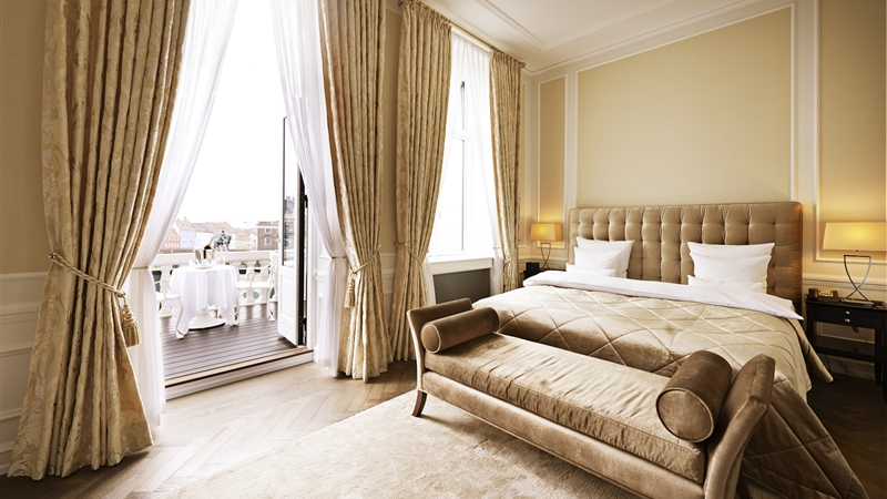 A beautiful room at the  Hotel d'Angleterre  opens onto a spacious balcony with a view of the city.