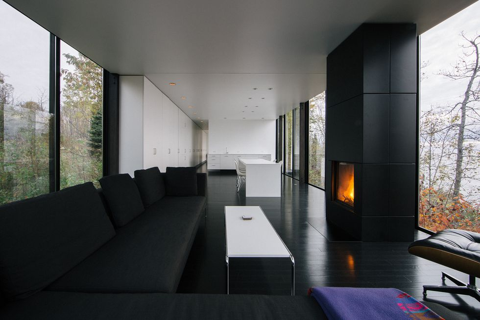 Chic and modern, this living room space provides endless views of the surrounding landscape. /  Source