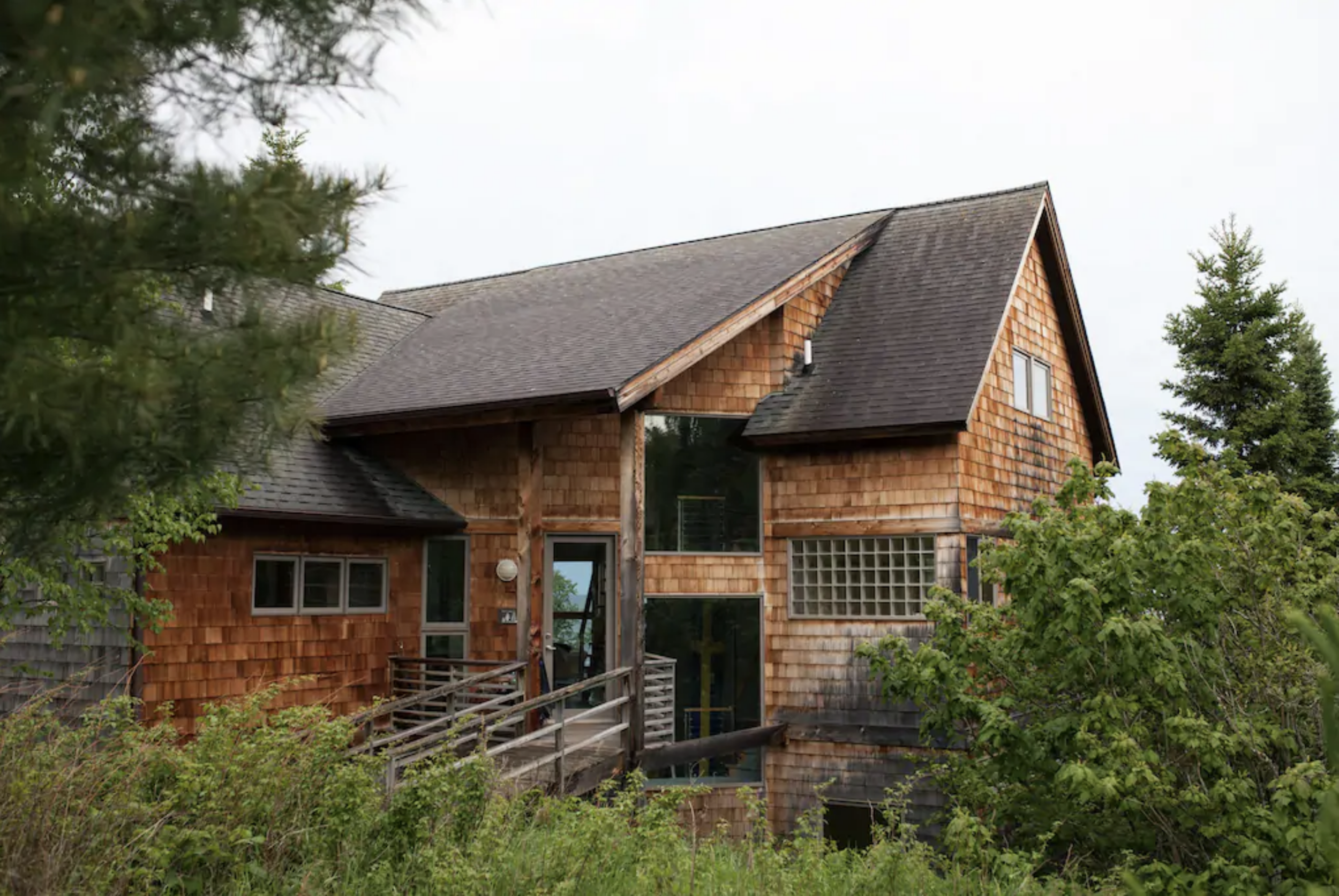 A majestic cedar shake cabin, Honeymoon House provides gorgeous views of Lake Superior's splendor. /  Source