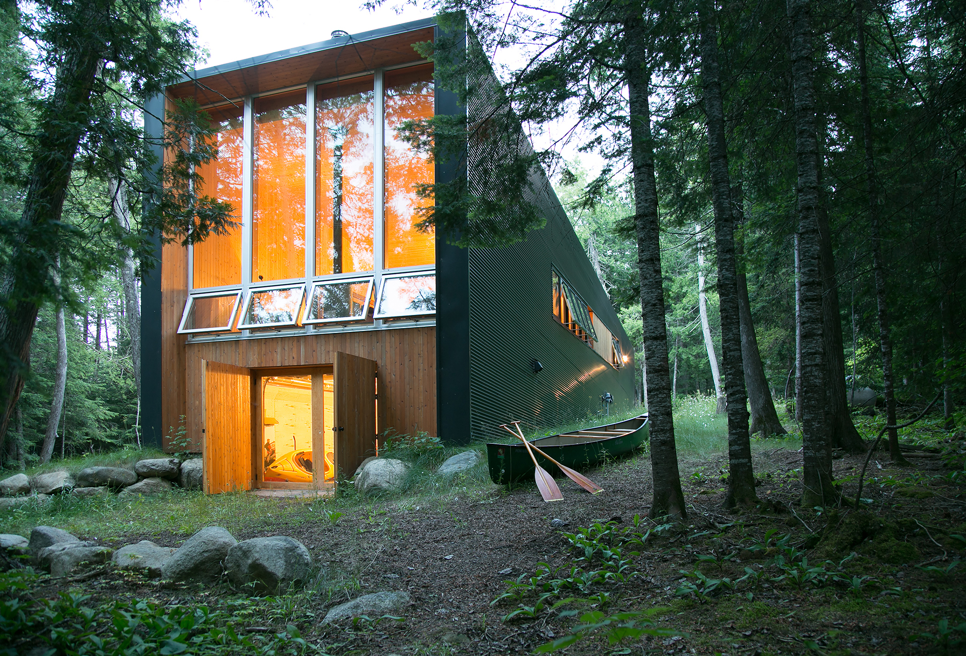 Sleek and modern, this cabin redefines a woodland getaway, and its simple paths to the lake offer serenity and calm. /  Source