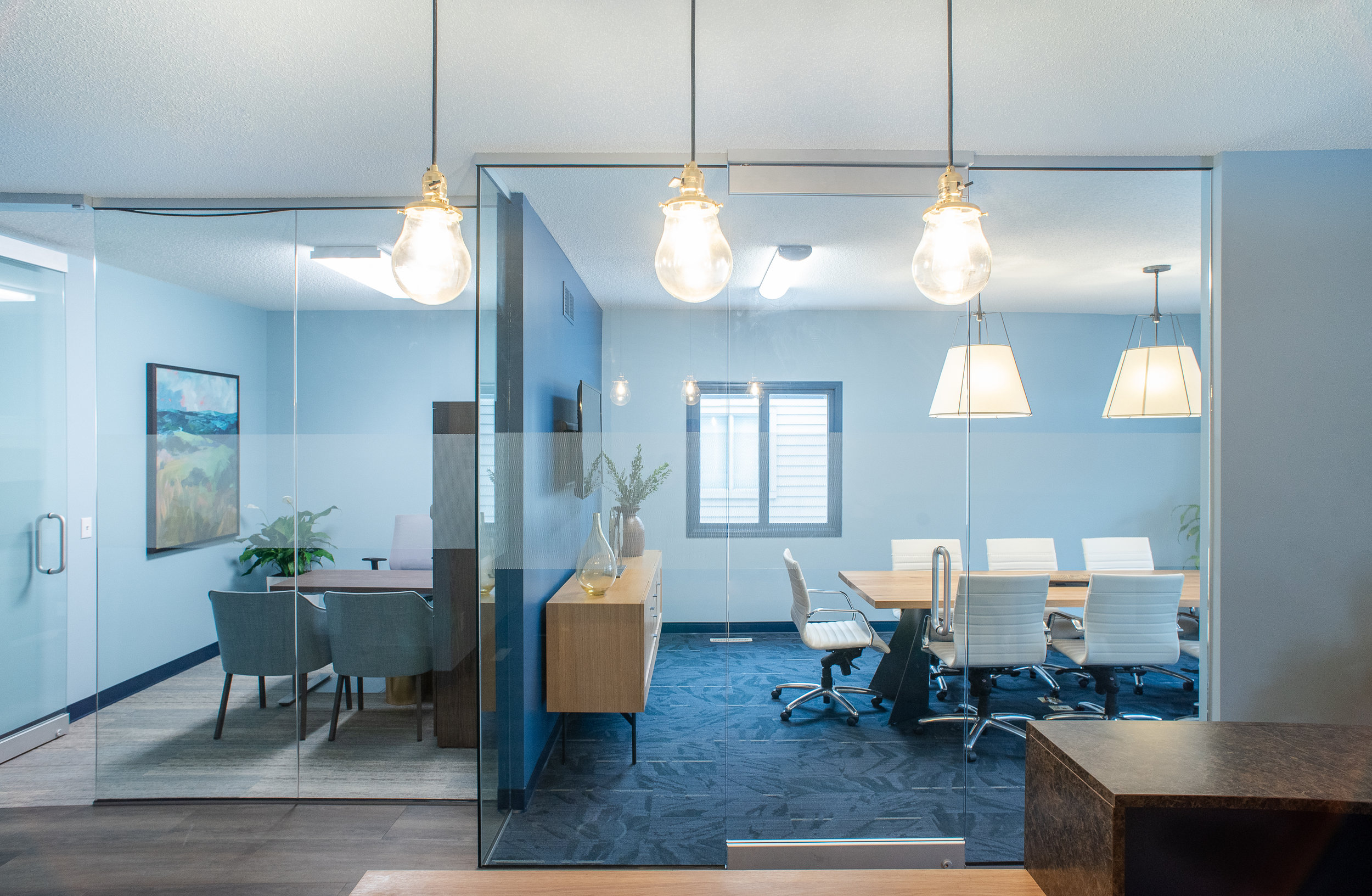 Glass windows and doors make it possible to have private meetings while still feeling visually connected to the rest of the office space. / Design by    Vela Creative