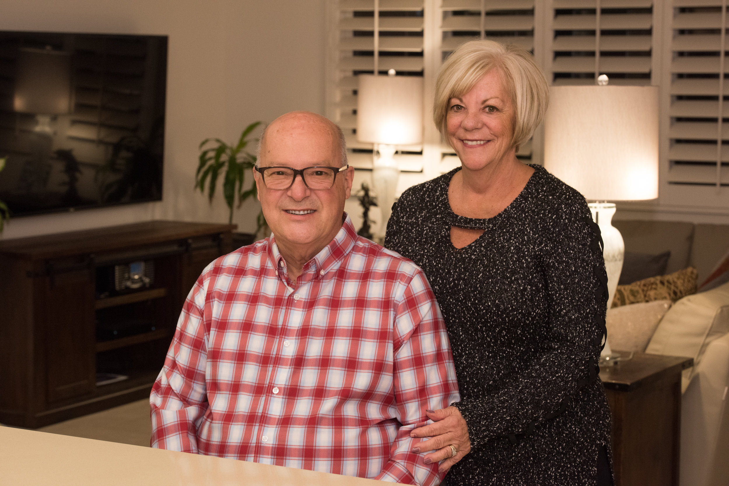Louis and Lynne in their Domani home.  (Photo Credit: Daniel J. Eslinger)
