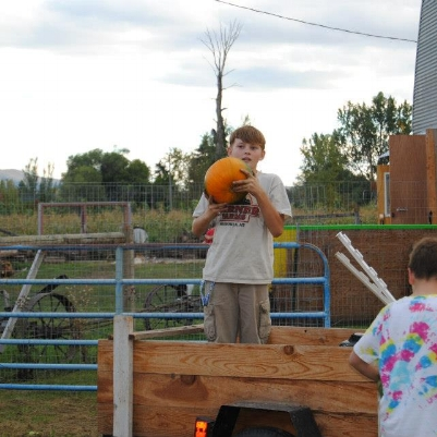OUR OLDEST SON WAS PART OF THE FIRST CLASS FROM HAWTHORNE SCHOOL TO HARVEST PUMPKINS AT THE FARM. SINCE THESE HUMBLE BEGINNINGS, OUR HARVEST HAS GOTTEN BIGGER, OUR TRAILER HAS GOTTEN BIGGER AND OUR SON HAS GOTTEN BIGGER TOO!