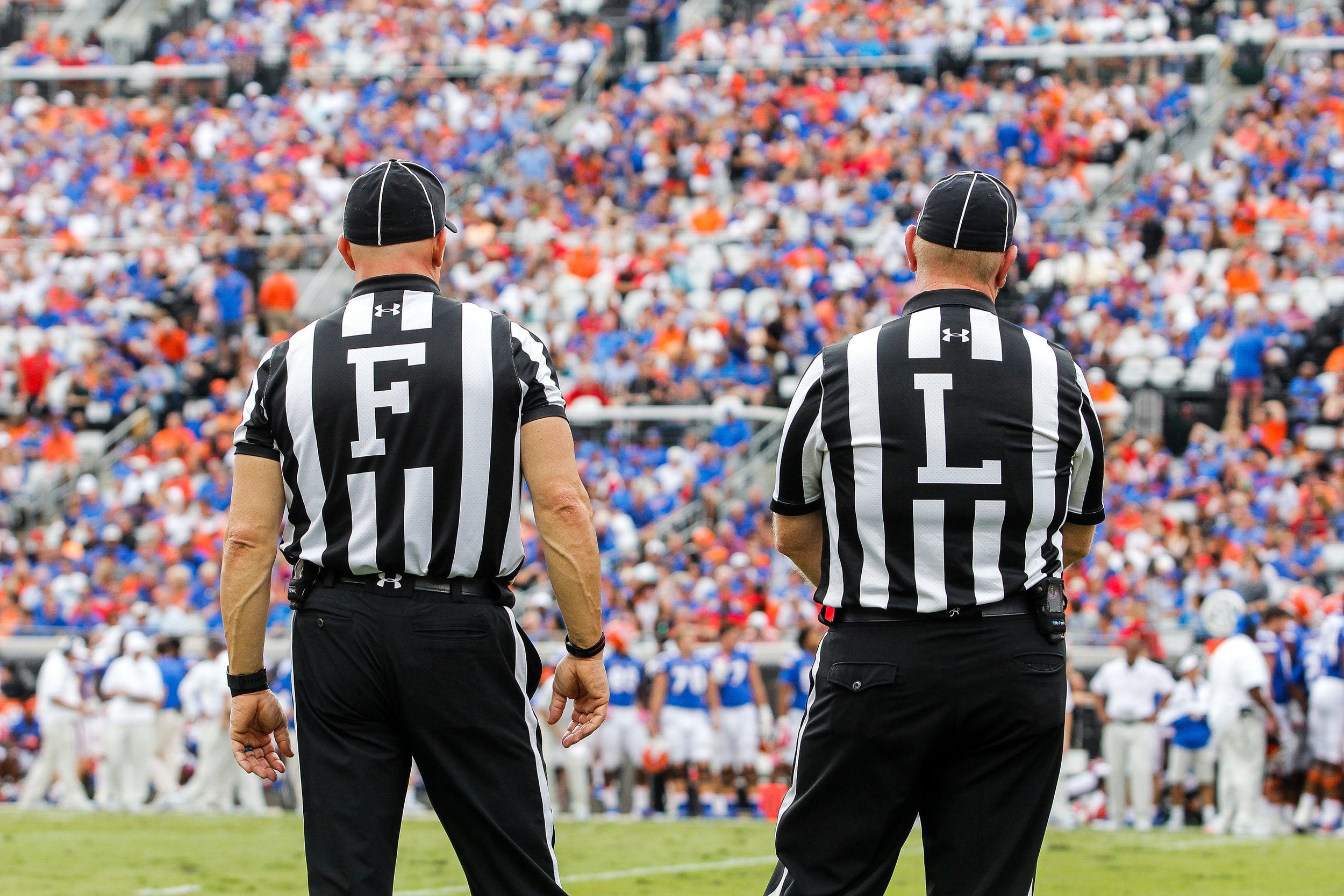 The field judge and the line judge stand on the sideline during a college football game between the University of Georgia and the University of Florida in Jacksonville, Fl., on Saturday, Oct. 28, 2017. The Bulldogs defeated the Gators, 42-7.