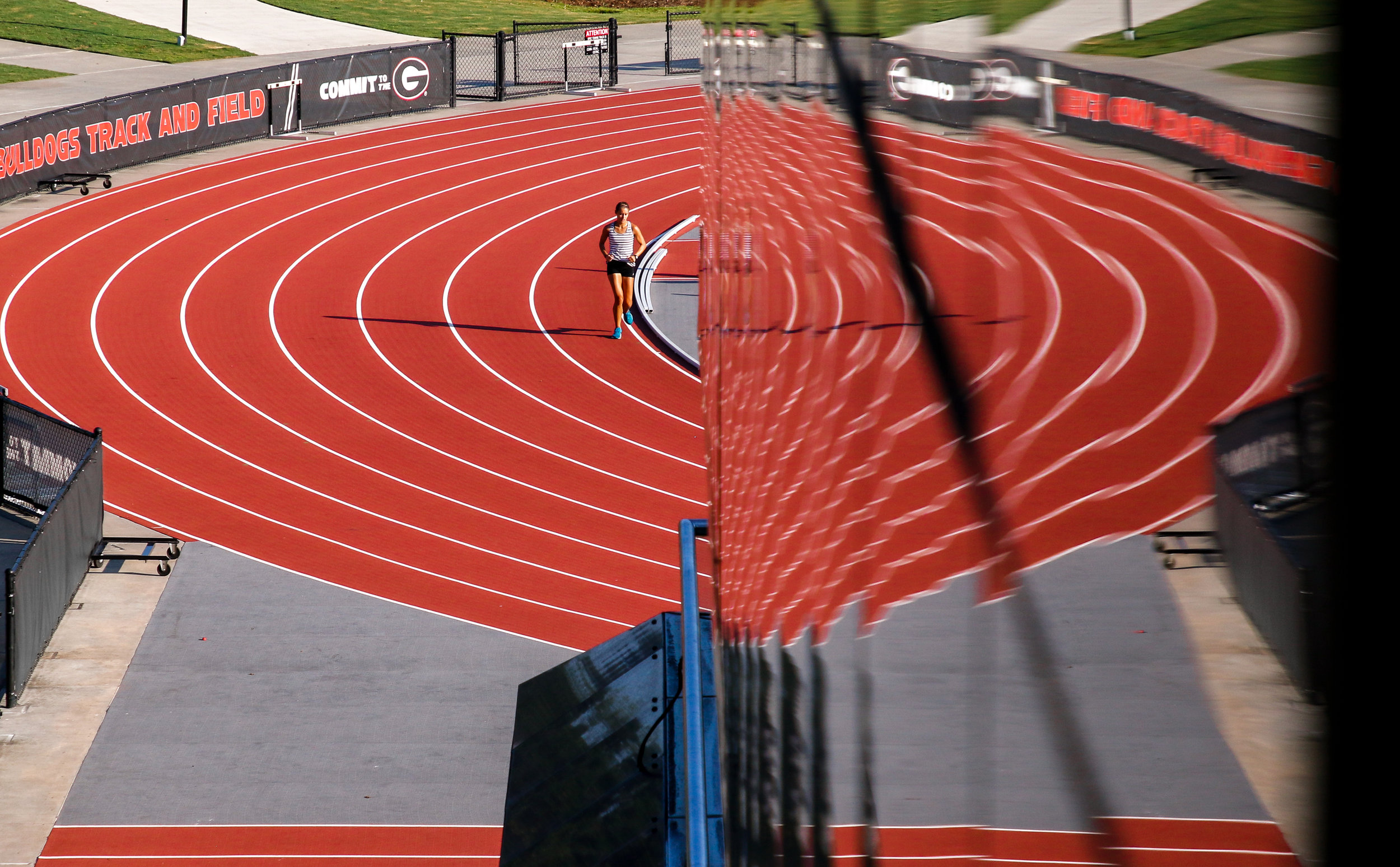 A runner jogs the inside curve of the Specs Towns Track in Athens, Ga., on Thursday, Aug. 9, 2018.